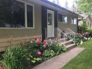 Charming bungalow with TWO garages on massive lot!