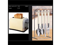 Brand new prolex toaster and 24 cutlery set