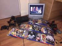 "Playstation 2 console with TELEVISION 15""screen and 27 games"