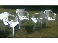Four white garden chairs