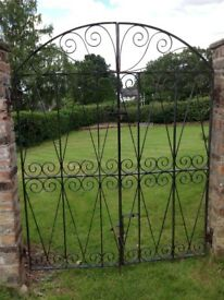 Wrought iron arched garden gates pair