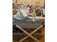 Baby boys blue Moses basket