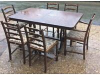 Ercol style dining table & 8 chairs