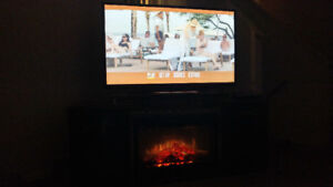 """60"""" Plasma LG Tv with Fireplace and heat."""