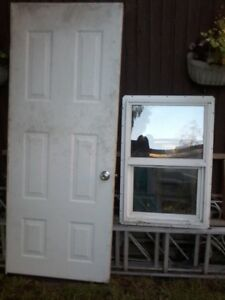 EXTERIOR   WHITE SOLID DOOR  AND SMALL WINDOW