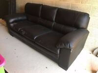 Black 3 seater leather sofabed.