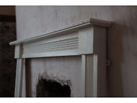 Small white wooden fire surround