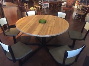 Patio Table with 6 Swivel Chairs. Steel base.