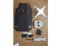 DJI Phantom 3 Advanced with Manfrotto D1 Drone and DSLR backpack and a spare battery.