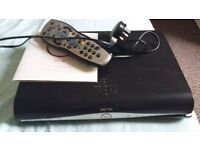 Sky + HD box with wire remote and info guide
