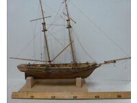Wooden model sailing ship (in need of repair).