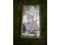 A SAMPLER WOOL PICTURE OF 2 CATS FRAMED AND GLAZED 19X10 INCHES