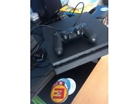 PS4 console with year live and 2 games