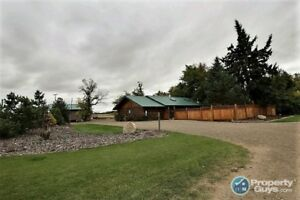 3 bed/1 bath home has a cozy feel with log construction.