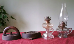 2 antique lamps and 2 irons with stand