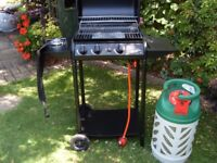 Gas barbeque with one side burner, only used once for family party comes with gas bottle