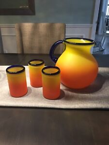 Mexican style glass pitcher and glasses.