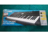 Casio CTK-1100 61 key keyboard in box with manuals, song book and adapter
