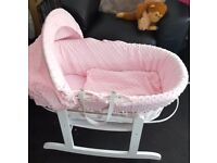 Pink and white wicker moses basket with rocking stand