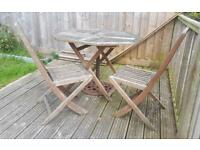 Hard wood garden set, 2 chairs and a table.