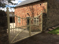 Architechural double cast iron entrance/driveway gates.