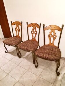 Three Antique Solid Wood and Brass Chairs