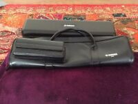 Yamaha 211 flute with additional curved headjoint and case.