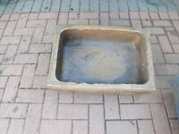 2 stone trough planters