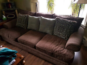 Couch, love seat, chair and a half, ottoman & pillows.