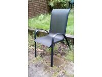Black glass top garden furniture. 4 chairs, 1 table and an umbrella.