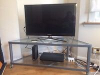 Clear Glass and Silver Metal TV Stand
