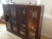 Vintage wooden school cabinet . Double fronted glass doors. One panel of glass missing .