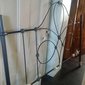 Kingsize metal headboard.
