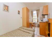 Modern second floor studio flat with open plan kitchen and en-suite shower/WC