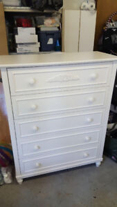 White dresser and twin bed