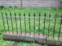 Metal Garden railings set in red sandstone