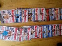 Mens' fitness magazines, most still in cellophane