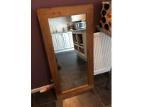New, lge mirror. solid, medium oak surround. 60cms x 120cms. Can be hung horizontally/vertically.
