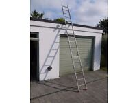 Lightweight multi-section metal ladder, about 12', plus stand-off