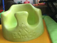 Baby seat. Bumbo. Absolute bargain. Green. Keeps baby safe.