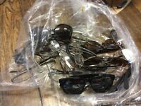 Job lot of glasses frames and some sunglasses.