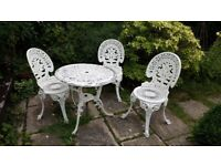 4 piece Cast Iron garden table and chairs