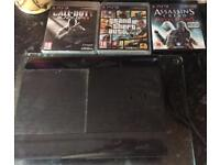 PS3 slim bundle (Console, games and leads)