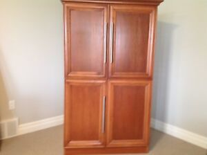 Custom Made armoire Size 38x 66 x 21 deep. Two years old.