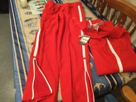 NIKE 'joggers' BRAND NEW WITH TAGS size medium 10-12 ish. Ankle zip & 2 front/rear pockets. BARGAIN.