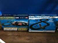 2 scalextric tracks and 4 cars with app cost £180