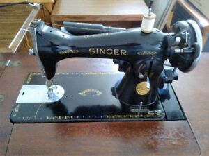 Vintage Singer Sewing Machine in cabinet.