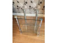 Clear glass & chrome 4 tier tv stand.
