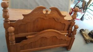 Queen Size bed with chest of drawers with mirror.