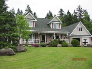 Custom home and large shop on 2.5 acres. Quispamsis.